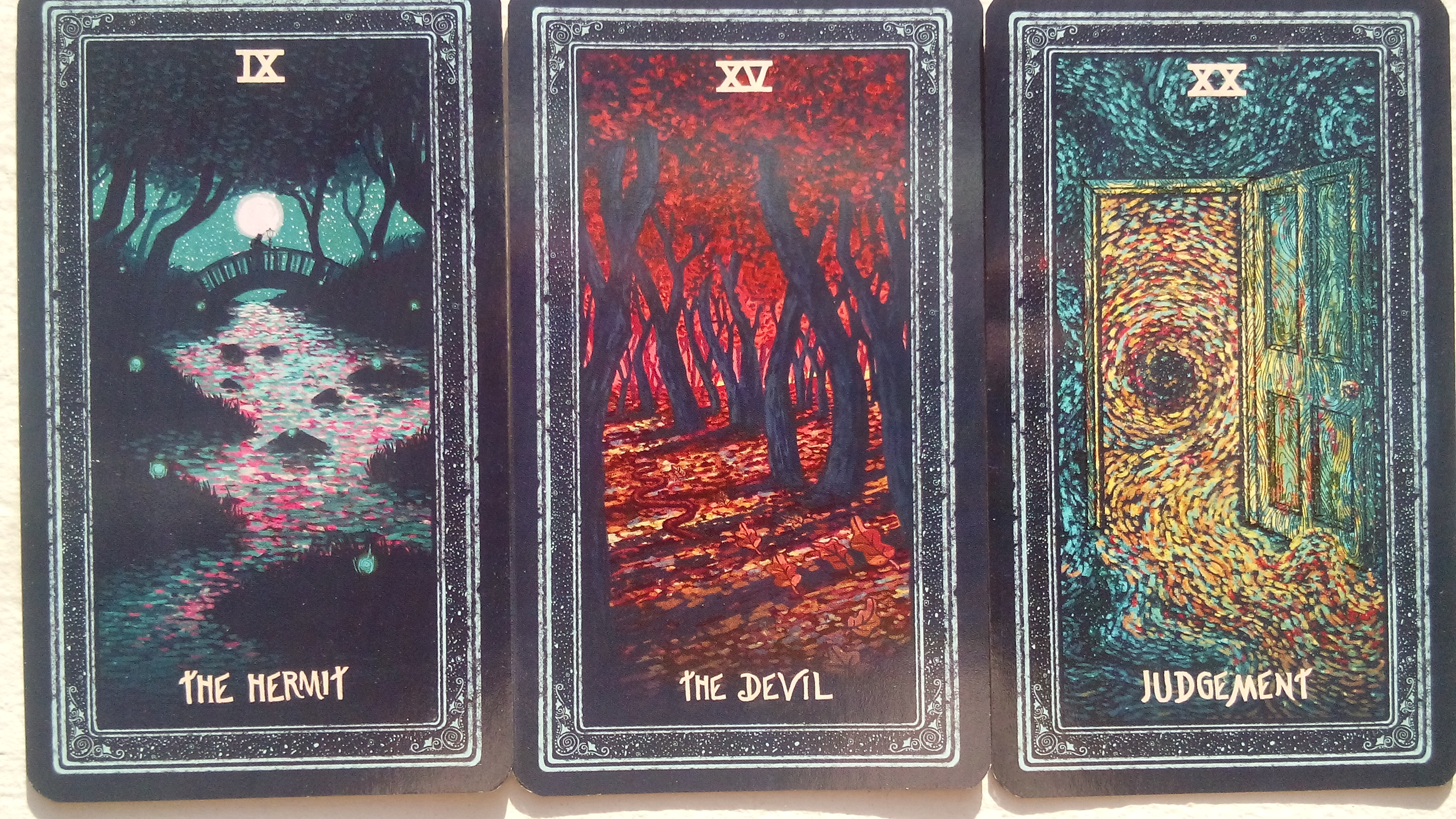 A Review of the Prisma Visions Tarot | Jack of Wands Tarot